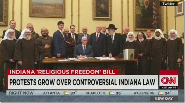 מעמד חתימת החוק באינדיאנה. במרכז מושל המדינה, מסביבו התומכים בחוק